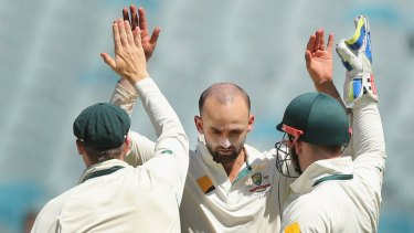 MELBOURNE, AUSTRALIA - DECEMBER 29: Nathan Lyon of Australia celebrates a wicket with Steve Smith (L) and Peter Nevill during day four of the Second Test match between Australia and the West Indies at Melbourne Cricket Ground on December 29, 2015 in Melbourne, Australia.  (Photo by Michael Dodge/Getty Images)