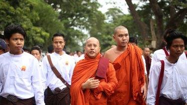 Myanmar's top Buddhist body has moved against nationalist Buddhist monk Wirathu, center.