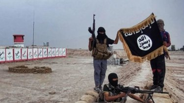 Symbols: Militants of the Islamic State of Iraq and the Levant (ISIL) posing with the trademark Jihadists flag.