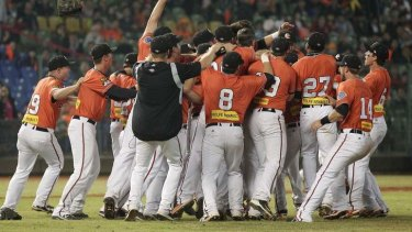 Australia's Canberra Cavalry players celebrate after defeating Taiwan's Uni-President 7-Eleven Lions 14-4.