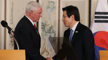 US Vice President Mike Pence, left, shakes hands with Hwang Kyo-ahn, South Korea's acting president.