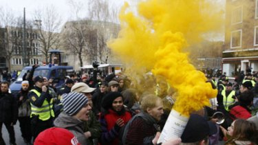 Smoke signals... protestors use coloured flares during yesterday's climate protests in the Danish capital.