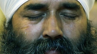 Tragedy ... a tear runs down the cheek of a member of the Sikh Temple of Wisconsin.