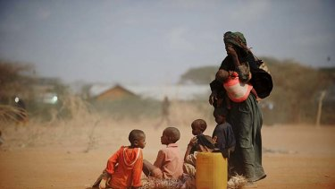 Sarura Ali and her six children wait outside a food distribution point in the Dadaab refugee camp in north-eastern Kenya.