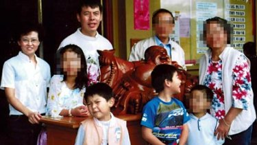Clockwise from left, Lillie, Min, Mr Lin's parents and nephew (all obscured), Henry, Terry and Brenda (obscured) in 2005.
