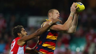 Lewis Jetta of the Swans competes for the ball with Sam Jacobs of the Crows.