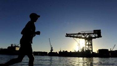 Sun sets on a Sydney icon ... the hammerhead crane at Garden Island.
