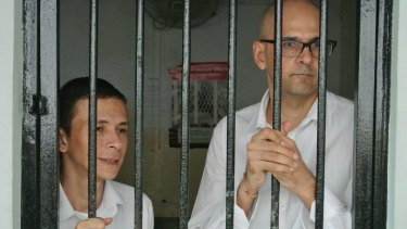 Ferdinant Tjiong (left) and Neil Bantleman, teachers at the newly named 'Jakarta Intercultural School' at the South Jakarta Court to face allegations of sexual assault against students.