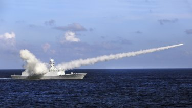 A Chinese frigate launches an anti-ship missile during military exercises in the South China Sea. Country's strategy is aimed partly at keeping the US at bay.