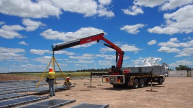 Renewables on the move: Contractors instal a mobile solar farm at New Century Resource's zinc mine and processing plant site, 250 kilometres northwest of Mt Isa, Queensland.