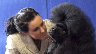 Owner Camilla Tell has a word of encouragement with Lex. Photo: Luis Ascui