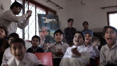 Pakistani orphans reacts while watching an early screening of the first episode of the animates Burka Avenger series, at an orphanage on the outskirts of Islamabad, Pakistan.