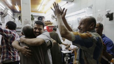 Egyptians celebrate at a tea house at Defense Minister Gen. Abdel-Fattah el-Sisi's announcement in Cairo's Zamalek district.