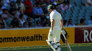 The lonely walk back ... Shaun Marsh leaves the field after being dismissed for another duck.