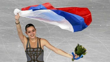 Controversy: Russia's Adelina Sotnikova celebrates holding her flag at the end of the Figure Skating Women's free skating Program.