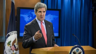 Secretary of State John Kerry gestures during a statement on the ongoing situation in Egypt before the start of a press briefing at the State Department in Washington.