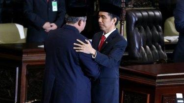 Outgoing president Susilo Bambang Yudhoyono and Joko Widodo.
