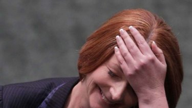 Julia Gillard enjoys a lighter moment during a fiery question time, in which she hit back at Opposition attacks on embattled Labor MP Craig Thomson.
