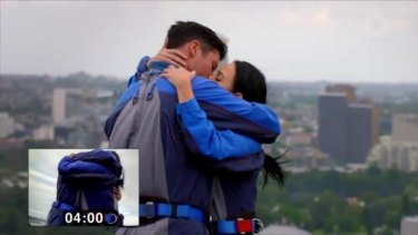 Sam Wood and Nina beat the world on-screen kissing record atop the Sydney Harbour Bridge.