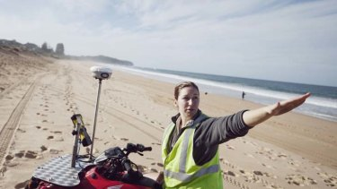 Location, location ...  Melissa Mole rides her quad bike on Narrabeen beach, plotting its fine structure at ground level as part of a sea-erosion study.