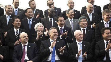 Treasurer Joe Hockey and  Reserve Bank governor Glenn Stevens with the G20 delegates in Sydney.
