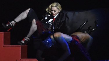 Madonna falls during her performance at the Brit music awards.