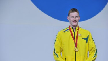 Rowan Crothers receives his gold mdeal in Glasgow.
