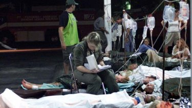 BALI  ... an Australian air force medic sits with injured Australians awaiting evacuation after the 2002 bombing.