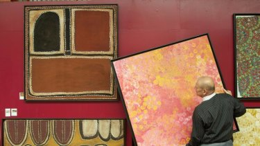 Ebes in his gallery with an Emily Kame Kbgwarreye painting entitiled 'My Country' from 1995.