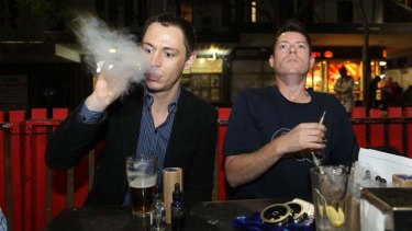 Recharging: Leon Alegria and Damian Duncan enjoy their electronic cigarettes at their local pub.