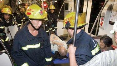 Rescuers evacuate an elderly man.