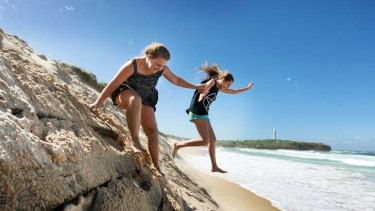 Eroded sand: Ashleigh Smith (left) and Michaela Norris play at City Beach, Wollongong.