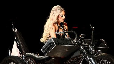 Lady Gaga on stage during a concert in her Born This Way tour.