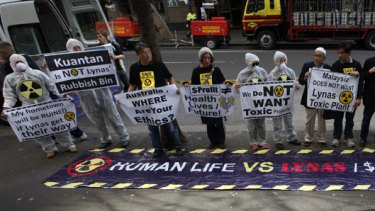 Australian and Malaysian activists protest outside the Sydney office of Lynas Corporation.