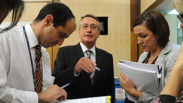 Wayne Swan briefs journalists during the 2010 budget lock-up.