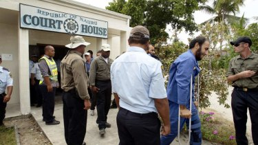 Asylum seekers attend the Nauru court to face charges of unlawful damage.