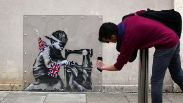 For sale ... the Banksy mural, <i>Slave Labour</i>, created on a wall in North London is scheduled to be sold in Miami this week.