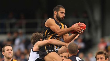 It's mine: Richmond's Bachar Houli wins the ball in a pack of Cats.