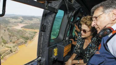 President Dilma Rousseff accompanied by Minas Gerais state Governor Fernando Pimentel, looks out over the dam site.
