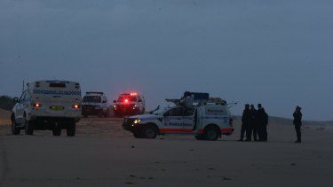 Police at the scene where two bodies washed up on Stockton Bight.