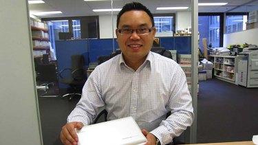 Victor Ng with his Fujitsu ScanSnap scanner.