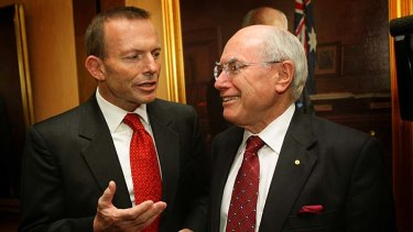 """The last prime minister who """"cheated"""" the public ... former prime minister John Howard, right, with the Opposition Leader, Tony Abbott."""