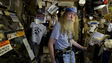 Trigger figure ... Dent Myers, above, the outspoken owner of an American Civil War surplus stoer in Kennesaw.
