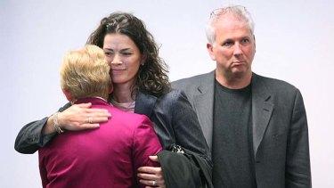 Nancy Kerrigan, centre, hugs her mother Brenda as her husband Jerry Solomon looks on.
