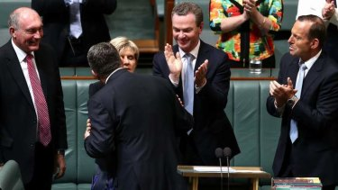 Treasurer Joe Hockey is congratulated by Foreign Affairs Minister Julie Bishop. Photo: Alex Ellinghausen