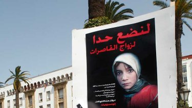 Women hold posters of victims as they protest in support of Amina Filali who committed suicide last week, in front  ofthe Moroccan parliament in Rabat.
