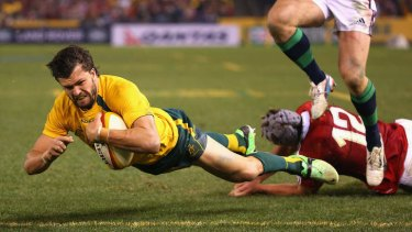 Adam Ashley-Cooper scores a try for the Wallabies against the Lions on Saturday night.