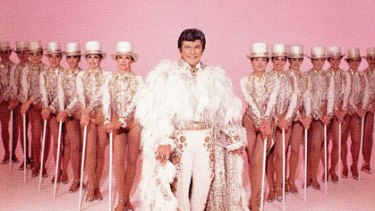 Flamboyant ... Liberace with the Radio City Music Hall Rockettes in 1984.