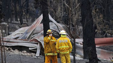 Firefighters inspect the devastation at Churchill.