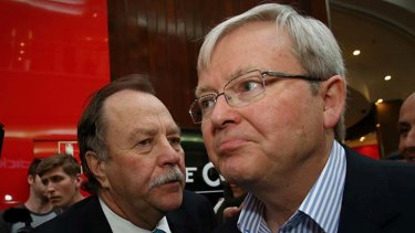 Chaotic style: Former prime minister Kevin Rudd with adviser Bruce Hawker on the campaign trail during the 2013 federal election.